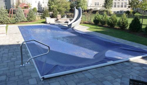 Automatic Pool Cover in blue with hidden track