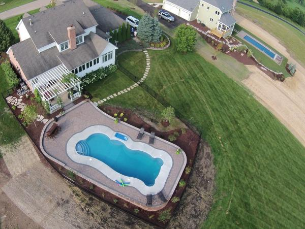 fiberglass Pool with stairs before landscaping