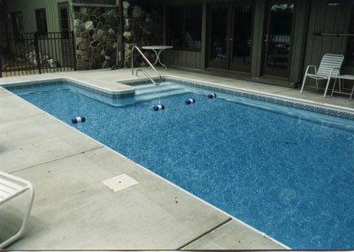 photo of pool and stair entry near house