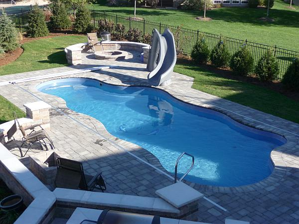 pool with patio firepit
