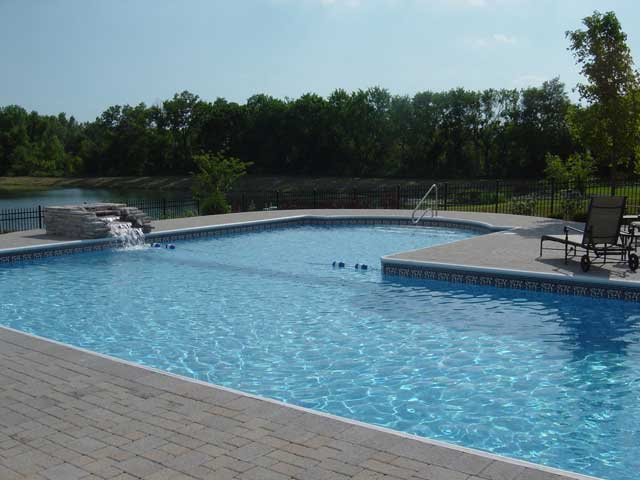 photo of large L shaped pool and stone waterfall Plainfield, IL