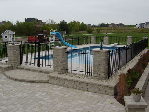 photo of pool with stone column fence Yorkville, IL